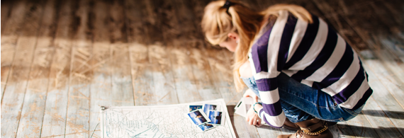 Young woman looking at a map