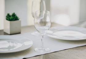 Restaurant table with white tablecloth and wine glasses