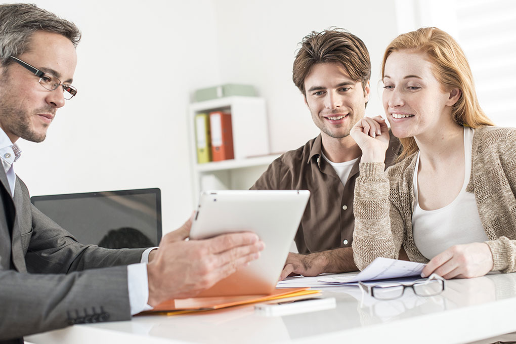 Real estate agent counsels young couple